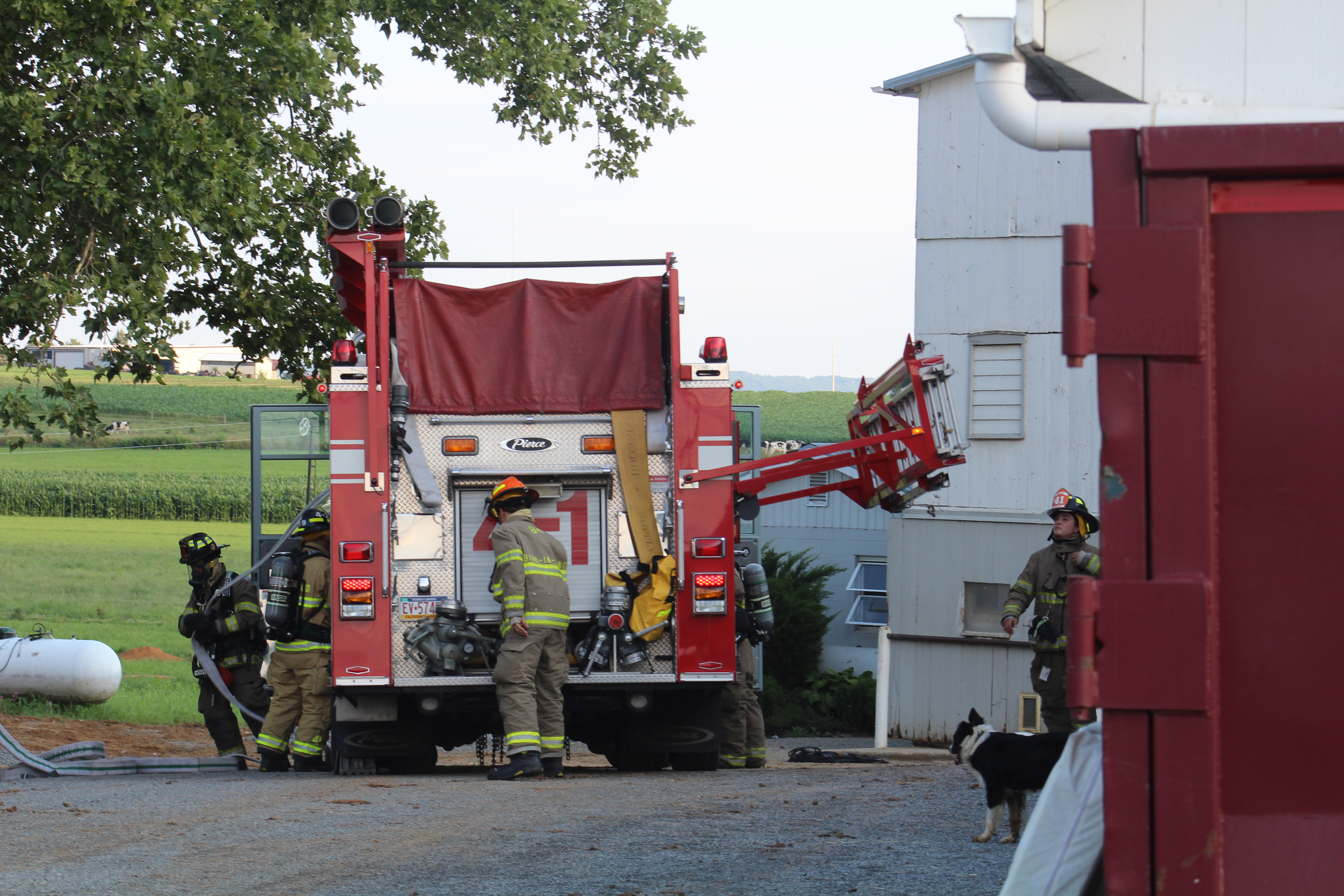 Engine 41-1 crew advances a handline at an acquired structure training.