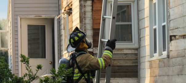 Firefighter Andrew Beiler raises a ladder at an acquired structure training.